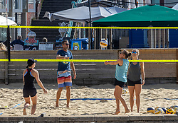 Licensed to London News Pictures. 23/09/2021. Brighton, UK. Beach volleyball players enjoy the sunny weather on Brighton beach, Sussex as weather forecasters predict warm autumnal weather to continue for the weekend with highs of 24c. Photo credit: Alex Lentati/LNP