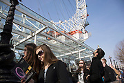 Tourists near to the London Eye, one of the biggest draws for tourism down on the Southbank. The South Bank is a significant arts and entertainment district, and home to an endless list of activities for Londoners, visitors and tourists alike.