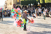 A balloon seller in the Jardin town square in the colonial UNESCO Heritage city of San Miguel de Allende, Mexico.