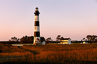 NC00713-00...NORTH CAROLINA...Sunrise at Bodie Island Lighthouse in Cape Hatteras National Seashore on the Outer Banks.
