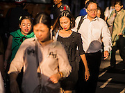 04 FEBRUARY 2015 - BANGKOK, THAILAND:  Pedestrians walk along Phloen Chit Road in Bangkok during the morning rush hour. After months of relative calm following the May 2014 coup, tensions are increasing in Bangkok. The military backed junta has threatened to crack down on anyone who opposes the government. Relations with the United States have deteriorated after Daniel Russel, the US Assistant Secretary of State for Asian and Pacific Affairs, said that normalization of relations between Thailand and the US would depend on the restoration of a credible democratically elected government in Thailand.   PHOTO BY JACK KURTZ