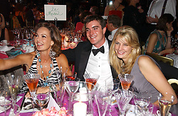 Left to right, COUNTESS MAYA VON SCHONBURG, LORD JAMES RUSSELL and CAMILLA VON STAUFFENBERG at the party Belle Epoque hosted by The Royal Parks Foundation and Champagne Perrier Jouet held at the Lido Lawns of the Serpentine, Hyde Park, London on 14th September 2006.<br /><br />NON EXCLUSIVE - WORLD RIGHTS