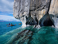 PUERTO RIO TRANQUILO, CHILE - CIRCA FEBRUARY 2019: Tourists kayaking around the Marble Chapel, (Capilla de Marmol) over Lake General Carrera close to Puerto Rio Tranquilo in Chile.