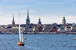Tourists in sailboat with churches in the background, Gamla Stan, Stockholm, Sweden