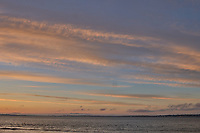 Sunrise Panorama over the Tagus River in Lisbon. Four of eight images taken with a Leica CL camera and 23 mm f/2 lens (ISO 200, 23 mm, f/8, 1/60 sec). Raw images processed with Capture One Pro and AutoPano Giga.