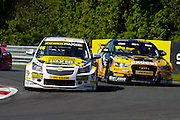 Josh Cook defends from Rob Austin during the Dunlop MSA British Touring Car Championship at Oulton Park, Budworth, Cheshire, United Kingdom on 7th June 2015. Photo by Aaron Lupton.
