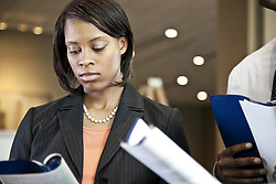 June 17, 2010 - A black businesswoman reading a report. (Credit Image: © Mint Images via ZUMA Wire)
