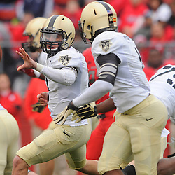 10 November 2012: Army Black Knights quarterback Trent Steelman (8) pitches the ball to running back Raymond Maples (1) during NCAA college football action between the Rutgers Scarlet Knights and Army Black Knights at High Point Solutions Stadium in Piscataway, N.J.. Rutgers defeated Army 28-7.