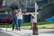 A film crew interviewing neighbors of Markus Kaarma and Diren Dede in the Grant Creek neighborhood of Missoula, Montana. Kaarma is accused of shooting and killing Diren Dede, a German exchange student in his garage on April 27, 2014.
