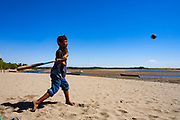 11 JANUARY 2007 - LEON, NICARAGUA:  A boy takes a swing at a pitch while playing baseball the beach in Las Peñitas, Nicaragua, about 10 miles from Leon. Nicaragua's Pacific beaches are relatively undiscovered. Small hotels and rental homes are starting to be developed but there is nothing like the rampant commercial development of Mexico's Pacific beaches. Photo by Jack Kurtz / ZUMA Press