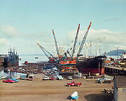 ackroyd-C02468-1. Willamette Western. Cranes at Astoria. Tugs. May 7, 1968 Ship on left is Northgate, on right is the M. S. Ringwood.