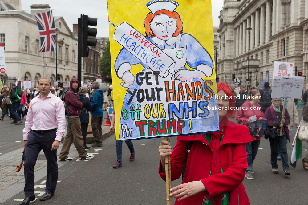 On US President Donald Trump's second day of a controversial three-day state visit to the UK, protesters march down Whitehall and voice their opposition to the 45th American President, down Whitehall, on 4th June 2019, in London England.