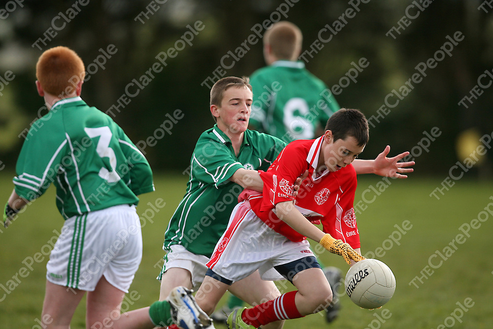 Eire Og's Michael Moloney holds off Kilrush's Dylan O' Connell during their Feile Final clash in Coolmeen on Sunday afternoon.<br /> Photograph by Yvonne Vaughan