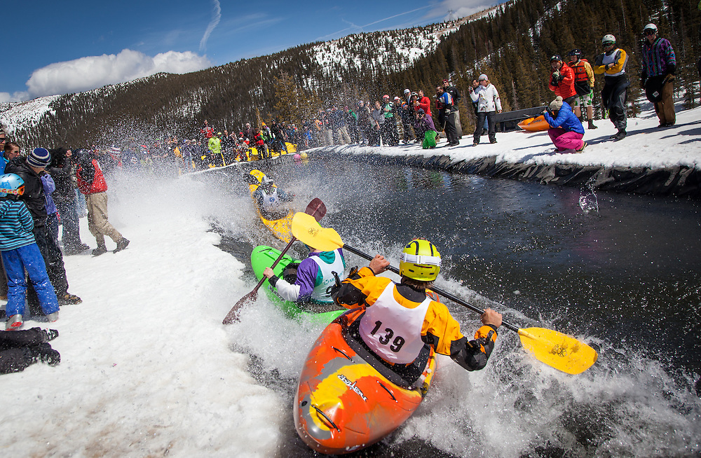 Kayakers race down a flume of snow into a pool of water in an annual celebration of spring.