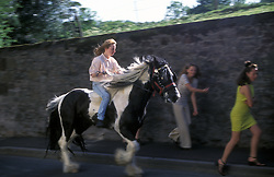 Gipsy woman riding piebald horse at Appleby Horse Fair in Cumbria UK