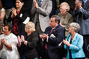 New Jersey Governor Chris Christie applaudes as Pope Francis enters the House Chamber as continues his six-day U.S. tour speaking to a joint meeting of Congress at the U.S. Capitol in Washington, District of Columbia, U.S., on Thursday, Sept. 24, 2015. The Pope is calling for Americans to do more to fight poverty, curb climate change and help immigrants. His visit runs through Sept. 27, and features stops in Washington, New York and Philadelphia. Photographer: Pete Marovich/Bloomberg