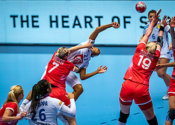 Estelle Nze Minko of France, Daria Dmitrieva of Russia, Kseniia Makeeva of Russia in action during the Women's EHF Euro 2020 match between France and Russia at Jyske Bank BOXEN on december 11, 2020 in Kolding, Denmark (Photo by RHF Agency/Ronald Hoogendoorn)