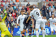 Fernando Llorente of Swansea city beats Everton goalkeeper Maarten Stekelenburg to score his teams 1st goal . Premier league match, Swansea city v Everton at the Liberty Stadium in Swansea, South Wales on Saturday 6th May 2017.<br /> pic by  Phil Rees, Andrew Orchard sports photography.