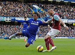 Chelsea's Juan Cuadrado and Burnley's Michael Kightly compete for the ball - Photo mandatory by-line: Mitchell Gunn/JMP - Mobile: 07966 386802 - 21/02/2015 - SPORT - Football - London - Stamford Bridge - Chelsea v Burnley - Barclays Premier League