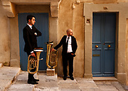 Bandsmen of the La Valette Band Club wait to take part in a Good Friday procession outside the Franciscan Church of St Mary of Jesus in Valletta, Malta March 30, 2018. Picture taken March 30, 2018. REUTERS/Darrin Zammit Lupi
