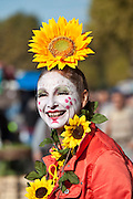 French clown with traditional white-painted face at market in La Reole, France