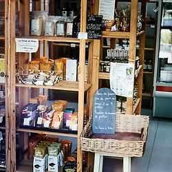 A view inside the local grocery store, from the outside. Saint-Pierre-de-Frugie, France. July 12, 2019.<br /> L'interieur de l'epicerie locale, vue de l'exterieur. Saint-Pierre-de-Frugie, France. 12 juillet 2019.
