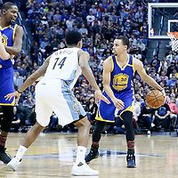 13 February 2017: Denver Nuggets forward Juancho Hernangomez (41) defends on Golden State Warriors forward Kevin Durant (35) as Denver Nuggets guard Gary Harris (14) defends on Golden State Warriors guard Stephen Curry (30) during the Denver Nuggets 132-110 victory over the Golden State Warriors, at the Pepsi Center, Denver, Colorado, USA.