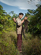 Deonicio holding a Coatie. Following a full day in the jungle, Deonicio Nate came back from a successfull hunt with 3 South American coatis and an Armadillo. His family is preparing and eating the animals, a welcomed source of protein.