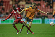 Björn Sigurðarson (Wolverhampton Wanderers) and Albert Adomah (Middlesbrough) during the Sky Bet Championship match between Middlesbrough and Wolverhampton Wanderers at the Riverside Stadium, Middlesbrough, England on 4 March 2016. Photo by Mark P Doherty.