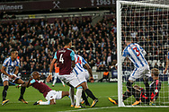 Andre Ayew of West Ham utd (2nd left) scores West Ham united's second goal of the game . Premier league match, West Ham Utd v Huddersfield Town at the London Stadium, Queen Elizabeth Olympic Park in London on Monday 11th September 2017.<br /> pic by Kieran Clarke, Andrew Orchard sports photography.