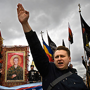 """Russian Neo-Nazis chant """"sieg heil"""" in Moscow during a demonstration to celebrate Hitler's birthday. Russia is experiencing a surge of extremism, sometimes resulting in violent attacks on foreigners."""
