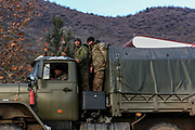A truck of Armenian armed forces are seen driving across the main highway towards Kapan, which is a provincial capital of Syunik Province in southeast Armenia on Friday, Dec 18, 2020. Kapan is located in the valley of the Voghji River and is on the northern slopes of Mount Khustup. Kapan lays along the disputed borderline with Azerbaijan with whom Armenia's long-standing frozen conflict escalated into a full scare of war for the 3rd time on Sept 27, 2020. (Photo/ Vudi Xhymshiti)