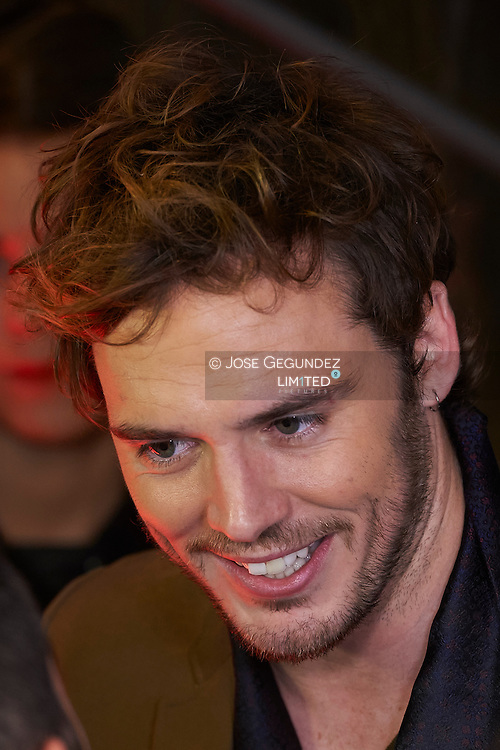 British Actor Sam Claflin attends the Premiere of 'The Hunger Games: Mockingjay Part 1' at Callao Cinema on November 11, 2014 in Madrid
