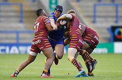 Warrington Wolves' Chris Hill is tackled by Huddersfield Giants Ukuma Ta'ai (left) and Adam O'Brien (rcentre) and Sebastine Ikahihifo (right) during the Betfred Super League match at the Halliwell Jones Stadium, Warrington.