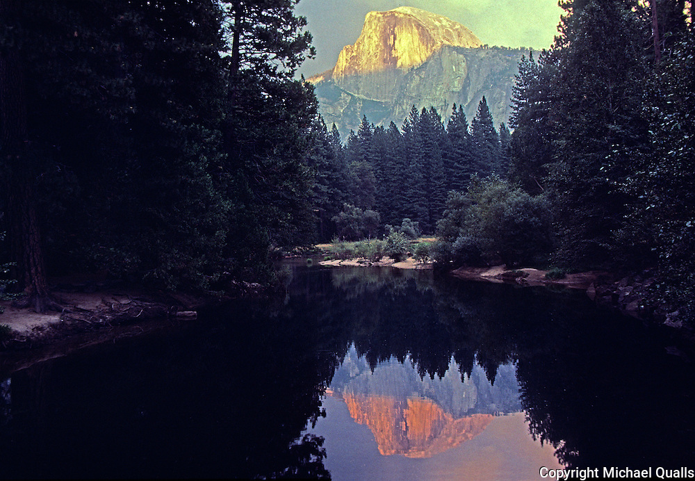 Halfdome reflected in the Merced River at sunset.  Yosemite, NP.  USA
