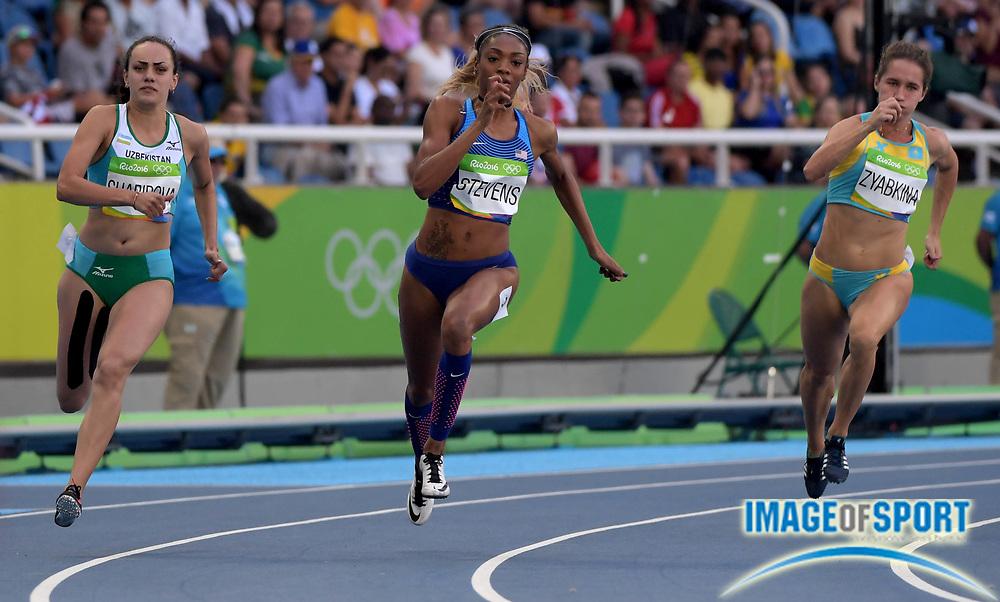 Aug 15, 2016; Rio de Janeiro, Brazil; Nigina Sharapova (UZB), left, Deajah Stevens (USA) and Viktoriya Zyabkina (KAZ) compete in the women's 200m athletics event at Estadio Olimpico Joao Havelange during the Rio 2016 Summer Olympic Games.