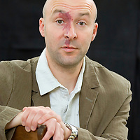 EDINBURGH, SCOTLAND - AUGUST13. Author Christopher Brookmyre poses during a portrait session held at Edinburgh Book Festival on August 13, 2006  in Edinburgh, Scotland. (Photo by Marco Secchi/Getty Images)