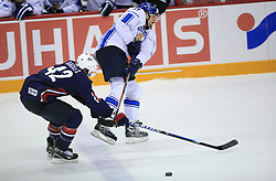 David Backes of USA and Mikko Luoma of Finland at play-off round quarterfinals ice-hockey game USA  vs Finland at IIHF WC 2008 in Halifax,  on May 14, 2008 in Metro Center, Halifax, Nova Scotia,Canada. Win of Finland 3 : 2. (Photo by Vid Ponikvar / Sportal Images)