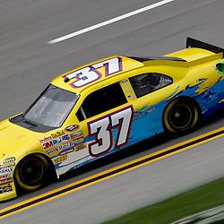 April 15, 2011; Talladega, AL, USA; NASCAR Sprint Cup Series driver Tony Raines (37) during practice for the Aarons 499 at Talladega Superspeedway.   Mandatory Credit: Derick E. Hingle