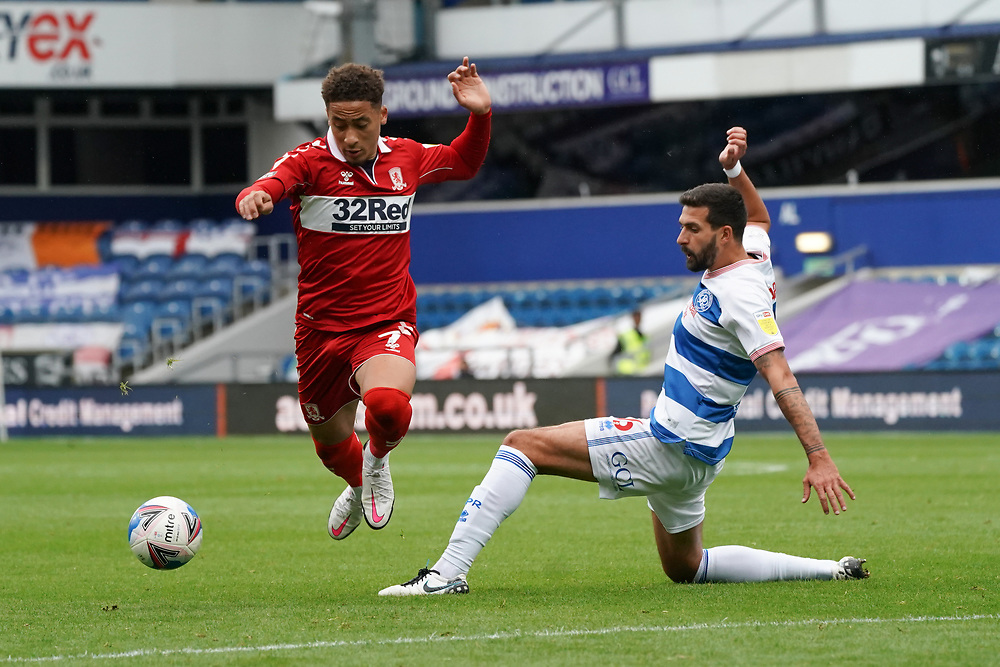 Middlesbrough's Marcus Tavernier is tackled by Queens Park Rangers player<br /> <br /> Photographer Stephanie Meek/CameraSport<br /> <br /> The EFL Sky Bet Championship - Queens Park Rangers v Middlesbrough - Saturday 26th September 2020 - Loftus Road - London <br /> <br /> World Copyright © 2020 CameraSport. All rights reserved. 43 Linden Ave. Countesthorpe. Leicester. England. LE8 5PG - Tel: +44 (0) 116 277 4147 - admin@camerasport.com - www.camerasport.com