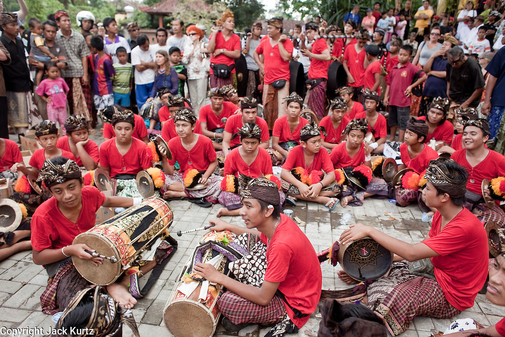 Apr. 25 -- UBUD, BALI, INDONESIA:  The orchestra performs at the funeral for Cokorde Gede Raka, a member of Ubud's royal family Sunday, Apr. 25. Balinese are Hindus and cremate their dead. Balinese funerals are elaborate - and expensive - affairs. A funeral for one person costs a minimum of 45 million rupiah (about $5,000 US). The body is placed into the bull's body at the cremation and cremated in the bull. The funeral pyre is burnt adjacent to the bull. That is what a family may earn in two to three years. The result is that only the rich can afford formal cremations. The body (in the casket) is placed in the top of the funeral pyre and the procession takes the body to the cremation site. The funeral pyre, and the body, are spun at intersections to confuse the spirits so the soul doesn't try to return to its home and to confuse evil spirits.    PHOTO BY JACK KURTZ