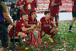 LIVERPOOL, ENGLAND - Wednesday, July 22, 2020: Liverpool's Harvey Elliott, Curtis Jones and Neco Williams celebrate with the Premier League trophy and their winners' medals as the Reds are crowned Champions after the FA Premier League match between Liverpool FC and Chelsea FC at Anfield. The game was played behind closed doors due to the UK government's social distancing laws during the Coronavirus COVID-19 Pandemic. Liverpool won 5-3. (Pic by David Rawcliffe/Propaganda)