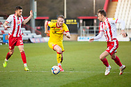 Stuart Sinclair of Walsall about to be tackled from both sides by Stevenage FC during the EFL Sky Bet League 2 match between Stevenage and Walsall at the Lamex Stadium, Stevenage, England on 20 February 2021.