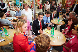 © Licensed to London News Pictures.  19/07/2014. Milton Keynes, UK. Labour leader ED MILIBAND speaks to volunteers at the MK International Festival, during a visit to the Centre:MK shopping centre in Milton Keynes. Photo credit: Cliff Hide/LNP
