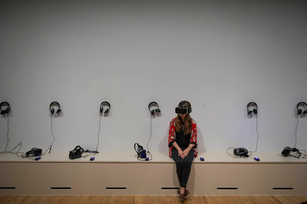 The Forests 2002/15 using Oculus virtual reality headsets - Carsten Höller: Decision is the artist's largest survey show in the UK to date. It immerses visitors in a series of experimental environments, exploring perception and decision making. Over the past 20 years Holler has created devices, vehicles and situations that alter visitors' physical and psychological states. Carsten Höller: Decision offers visitors the chance to see the world upside-down, experience uncanny bodily sensations and soar above London's traffic in a flying machine. Hoping to 'induce hallucinations, in the widest sense' Höller has populated the gallery with disorientating objects and installations, including giant revolving mushrooms and two robotically-engineered beds that – day and night – roam the exhibition like a pair of restless, insomniac twins. It culminates in the artist's Isomeric Slides. Accessed from Hayward Gallery's roof, these slides turn ordinary gallery activity on its head. In a setting usually reserved for contemplation, Höller's slides are an invitation to lose control. A slide, Höller has remarked, is both 'a sculpture that you can travel inside' and a 'device for experiencing a unique condition somewhere between delight and madness'. The exhibition runs from Wednesday 10 June – Sunday 6 September 2015 at the Haywayrd Gallery, London, UK. 09 June 2015.