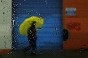 A pedestrian walks through the Chinatown-International District during rainstorms in Seattle. <br /> <br /> Erika Schultz / The Seattle Times