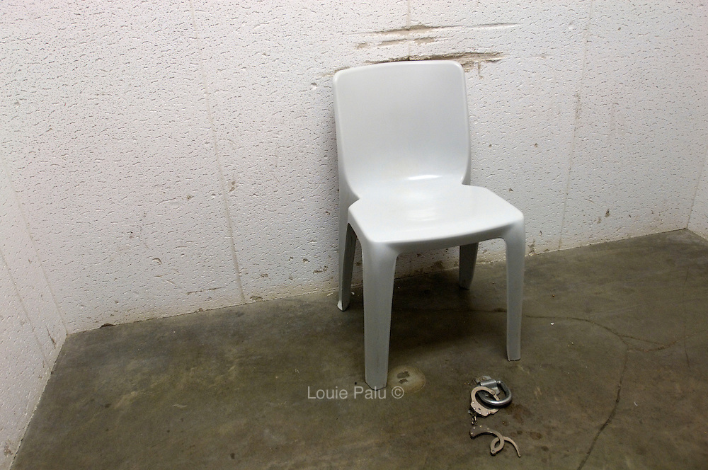 """A chair and leg restraint connected to the floor for a detainee inside an """"interview room"""" in Camp 5 ,which is a maximum-security detention facility where the most uncooperative as well as detainees with the most intelligence value are housed at the detention facility in Guantanamo Bay, Cuba. Approximately 250 """"unlawful enemy combatants"""" captured since the September 11, attacks on the United States continue to be held at the detention facility.(Image reviewed by military official prior to transmission)"""
