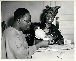 Jul. 07, 1953 - Delegates From Nigeria In London... For Talks With Colonial Secretary.. A party of Nigerians arrived in London. They are to attend a series of talks with Oliver Lyttleton on the future of the Nigerian Constitution and the question of self government in 1956. Keystone Photo Shows:- Mrs. Tanimowo Ogunlesi - who is the only woman in the party - pours tea for Mr. Obafemi Awolowo - the chief delegate - at break fast in their London hotel. (Credit Image: © Keystone Press Agency/Keystone USA via ZUMAPRESS.com)