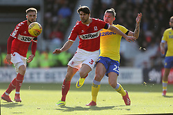 Middlesbrough's George Friend and Leeds United's Kalvin Phillips (right) challenge during the Sky Bet Championship match at The Riverside Stadium, Middlesbrough.