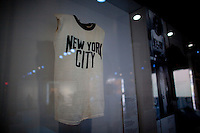 John Lennon's infamous New York City t-shirt on display at The Rock and Roll Hall of Fame Annex in New York City..(Photo by Robert Caplin)..